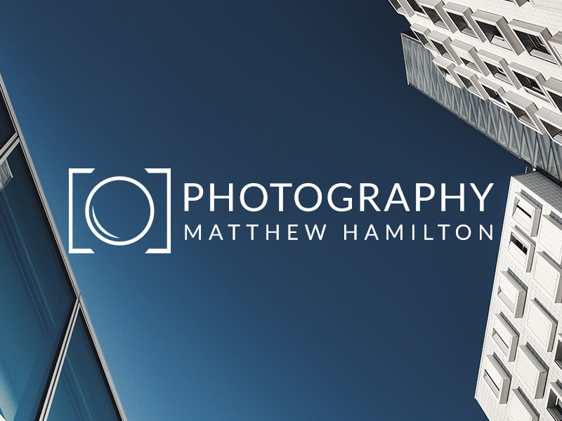 photography logo with a styled camera shape